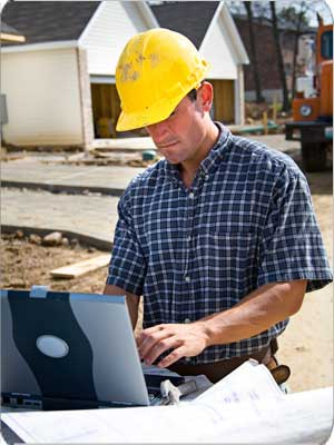 Construction Guy With Laptop
